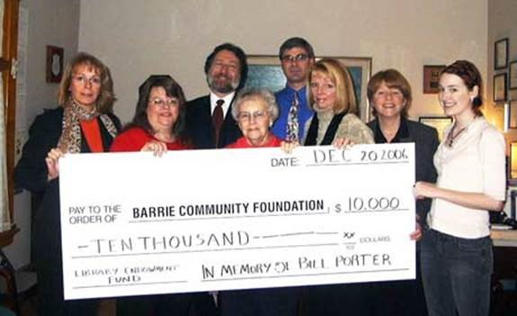 The Porter Family presents a cheque to the Barrie Community Foundation (BCF) to establish the William C. Porter Library Endowment Fund.